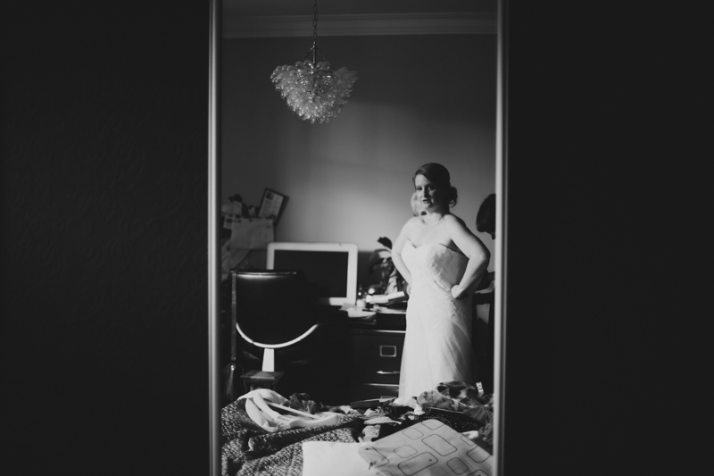 Bride looking in the mirror by Love oh love photography