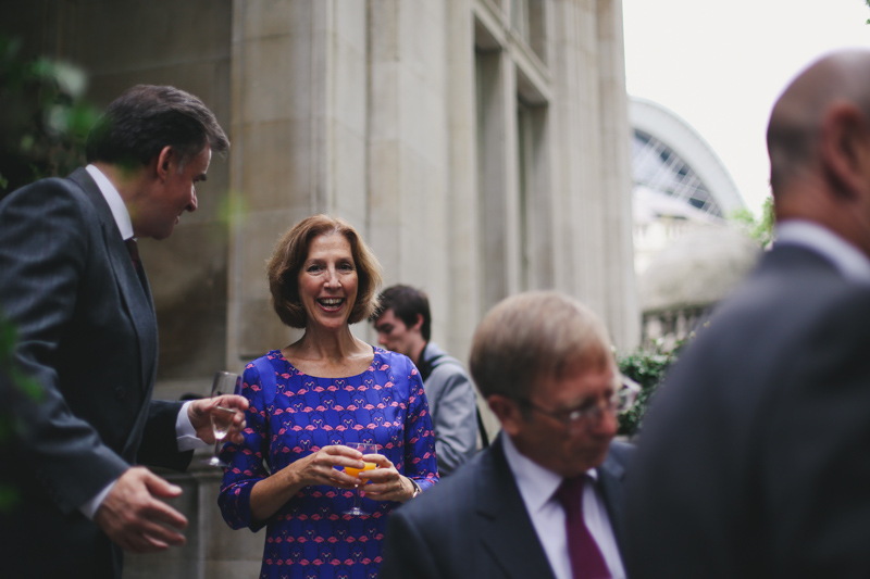 Laughing wedding guests at the national liberal club London by Love oh love photography