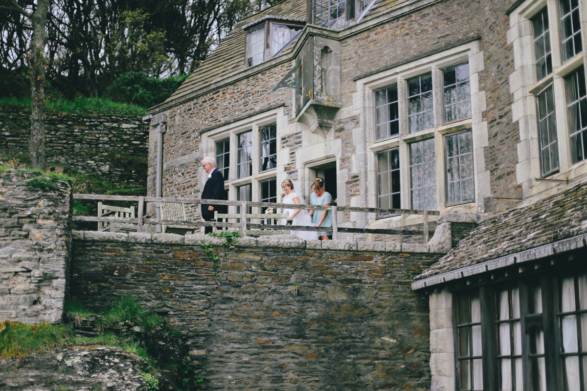 Walking down the aisle at Prussia Cove, Cornwall wedding by Love Oh Love Photography