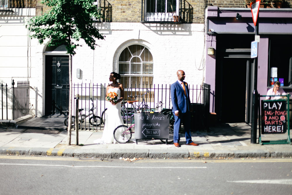 Bride and groom at Old Finsbury Town Hall, London by Love oh Love photography