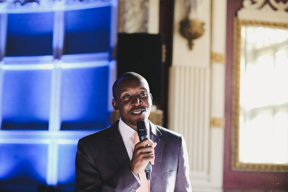groom laughing at wedding reception wedding speech at Old Finsbury Town Hall Guest at Old Finsbury Town Hall, London by Love oh Love photography